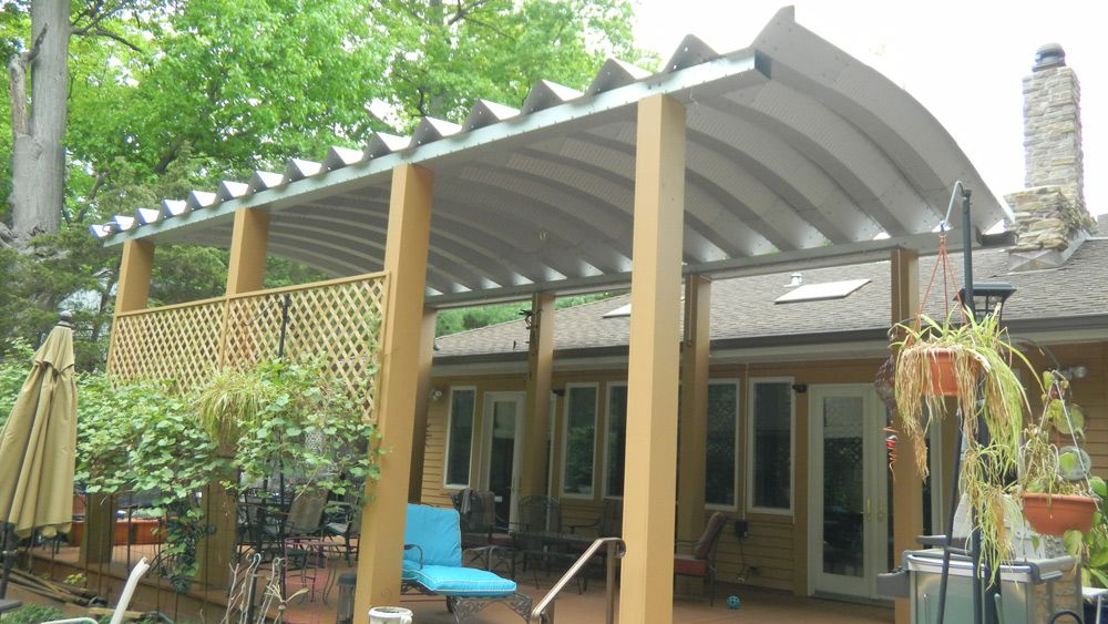 Added privacy to the backyard sitting area Metal carport