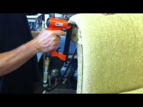 Upholstery stapler application shot Tacwise the firing equipment element of the package deal - seems easy