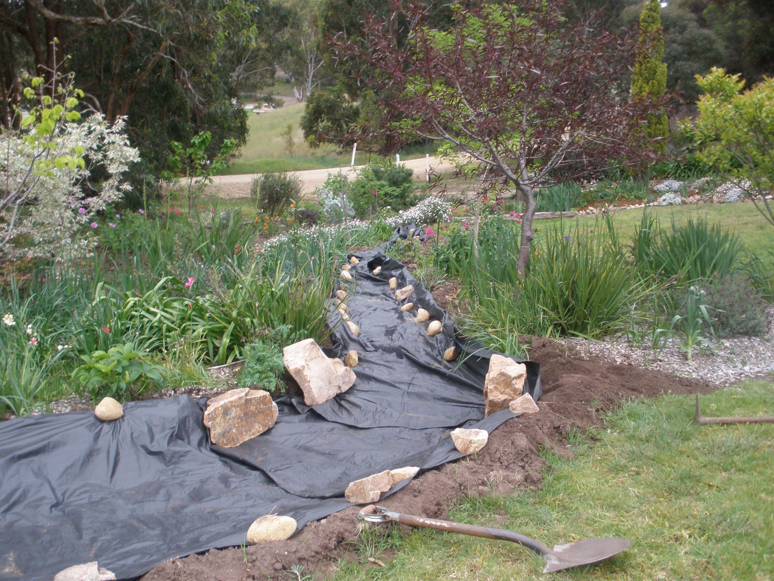 Dry Creek Bed Laying Foundational Tarp Mesh Dry Creek 400 x 300
