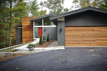Mid-Century Modern midcentury exterior with dark gray and wood Sherwin Williams Urbane Bronze SW 7048 Benjamin Moore Titanium 2141-60. Vertical grain clear cedar on the garage doors and chimney