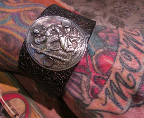 One of a kind adjustable soft leather cuff bracelet with antique Saint Christopher medal. This cuff will fit a wrist size 8. The actual medal