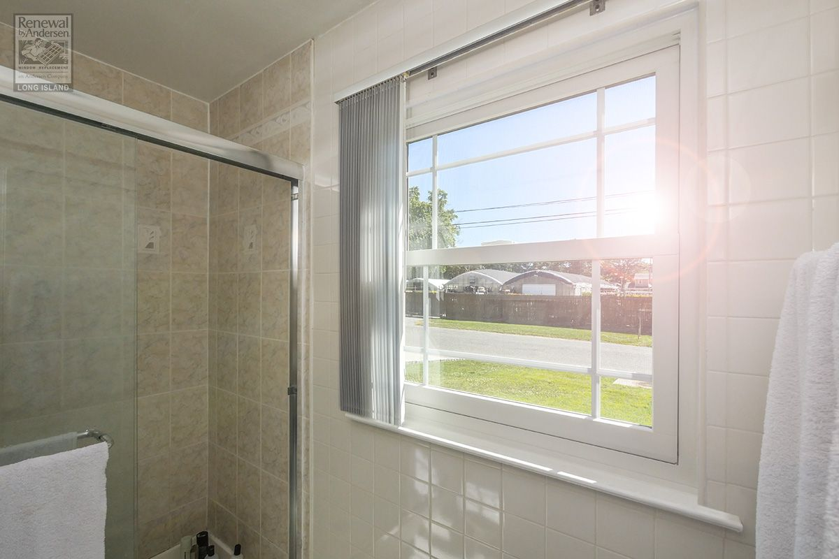 New large bathroom window with unique grilles that we ...