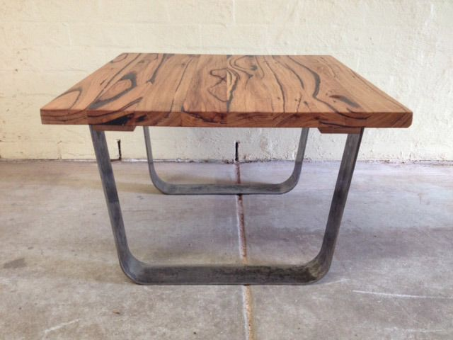 coffee table with metal legs by saw and grain