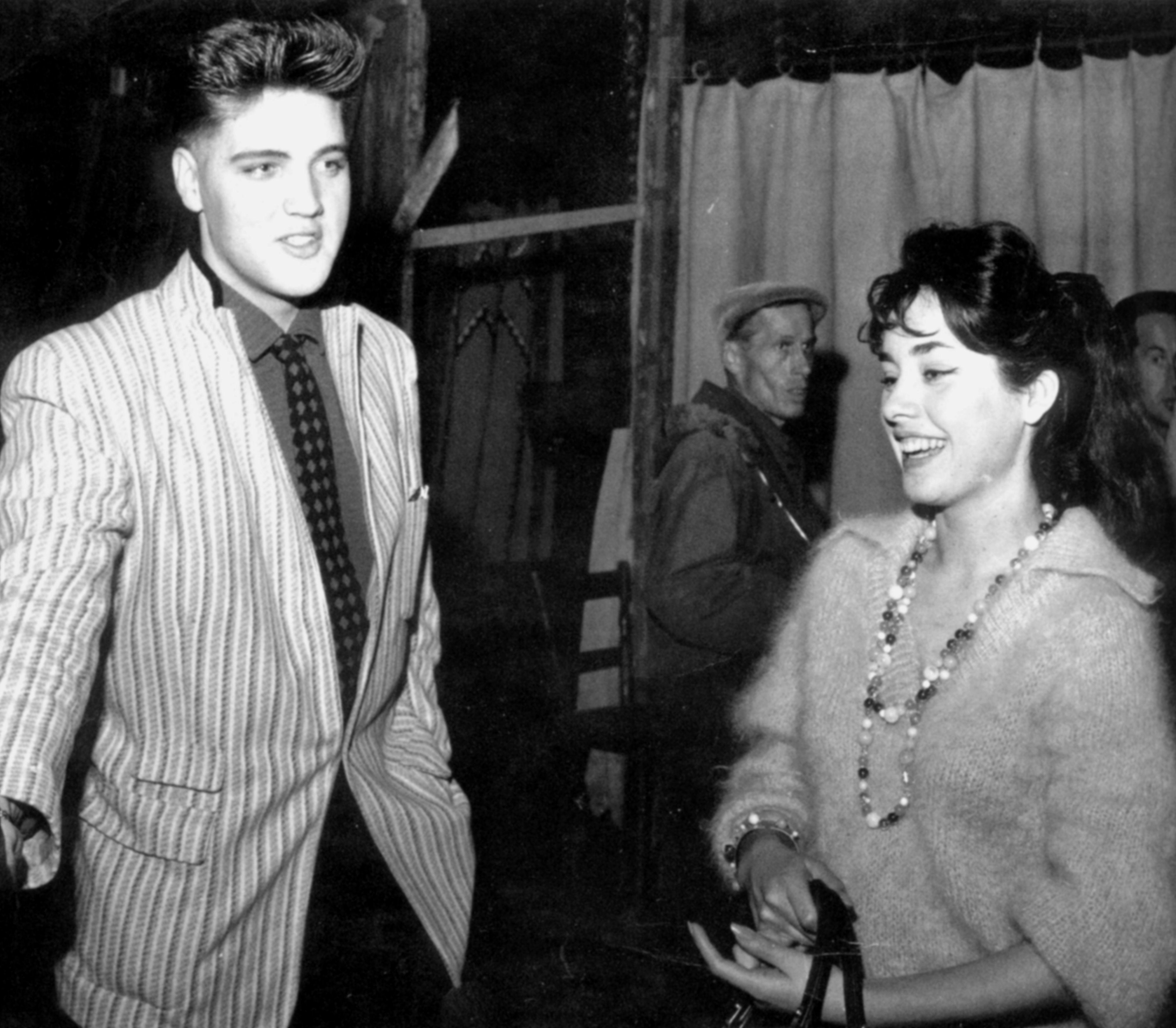 Elvis in march 5  1959 in Germany wearing for the last time that legendary green jacket here with his date Vera Tschechowa