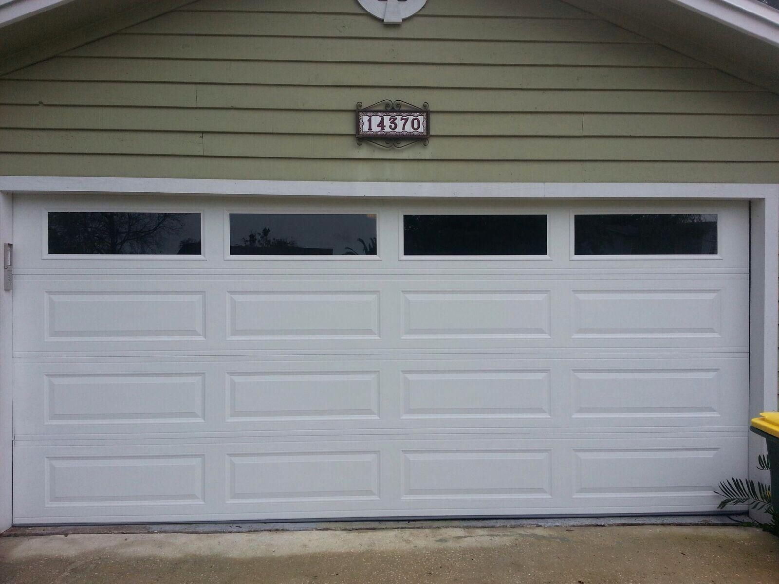 Amarr Long Panel Garage Door With Solid Windows Gives This