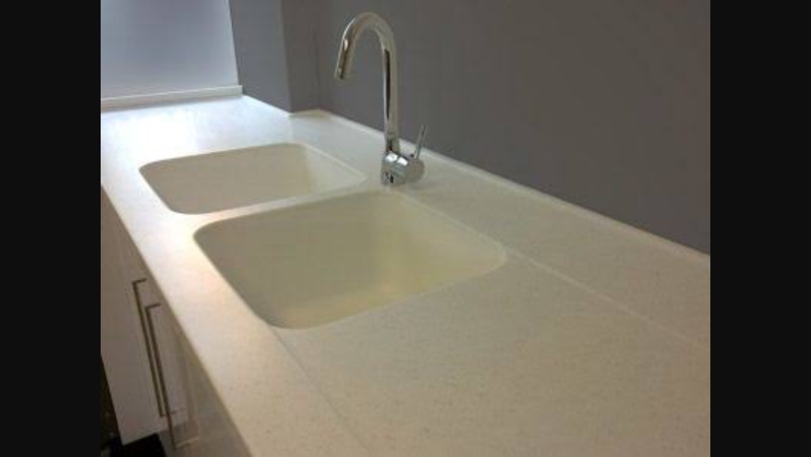 Photo 2:  Stunning Corian acrylic moulded benchtop with 2 sinks and draining area