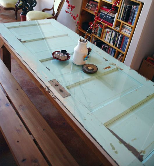 Old door table: antique door (covered with glass) on picnic table. Would  look great as dining room table with some more modern flare as decor. - DIY: Door Table-pinned By Www.auntbucky.com #door #DIY #table DIY