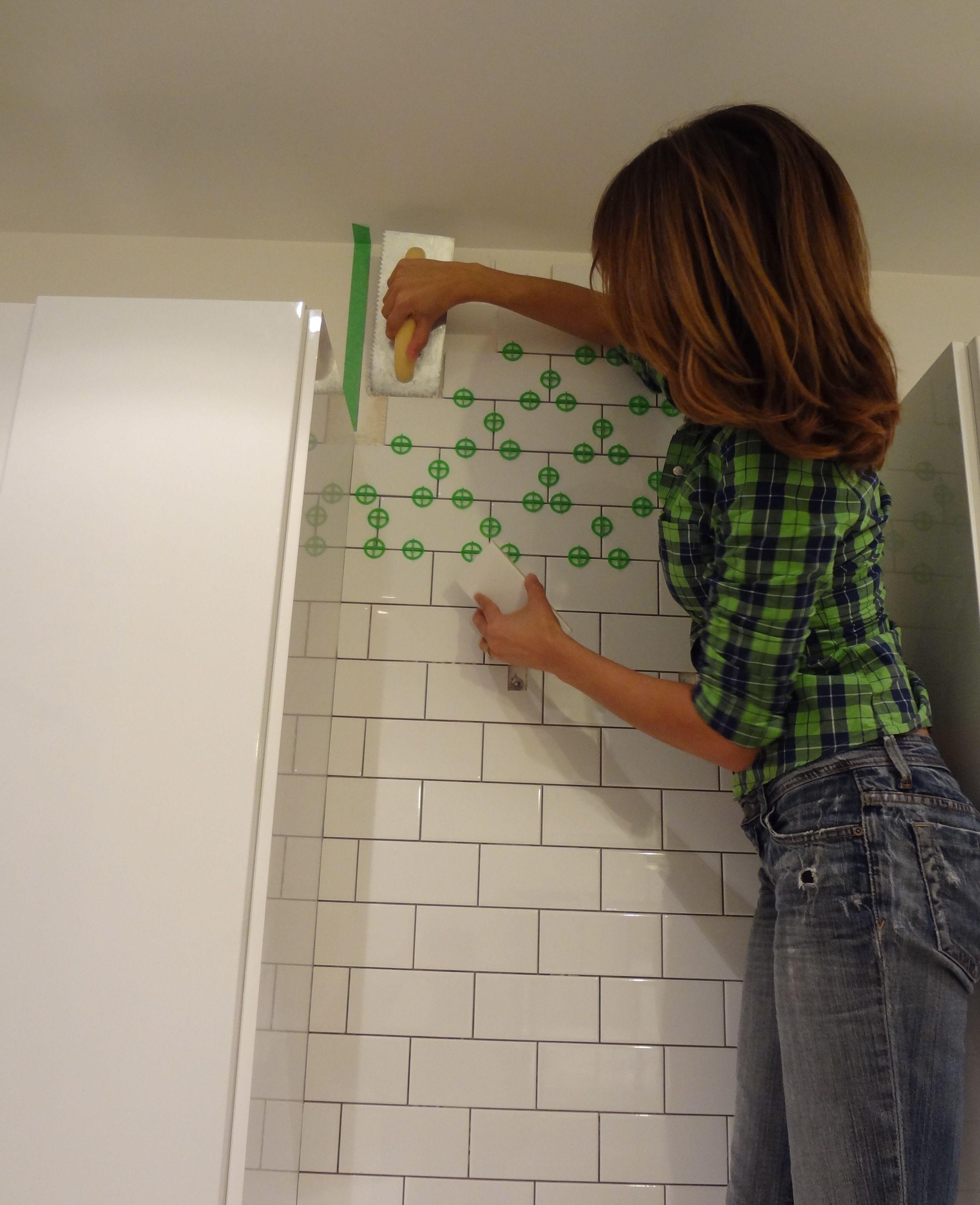 Tiling my kitchen backsplash with white subway tiles. I\'m using ...