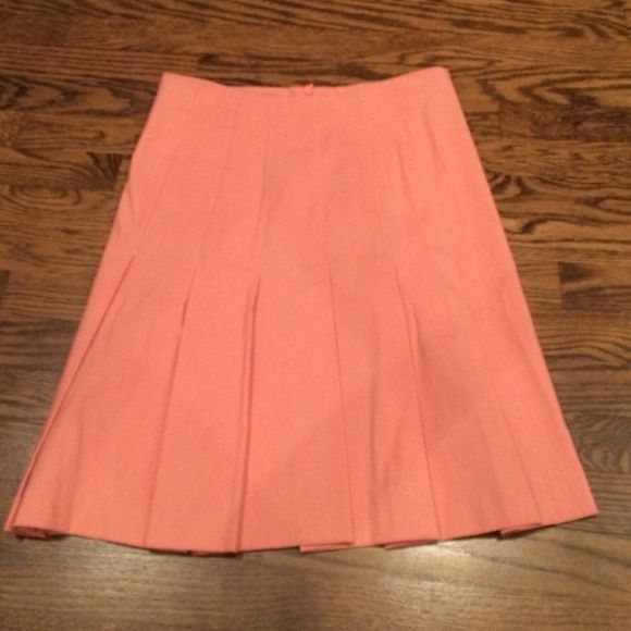 Pink pleaded skirt Pretty coral color skirt has loops in the back if u want to wear it with a belt Skirts