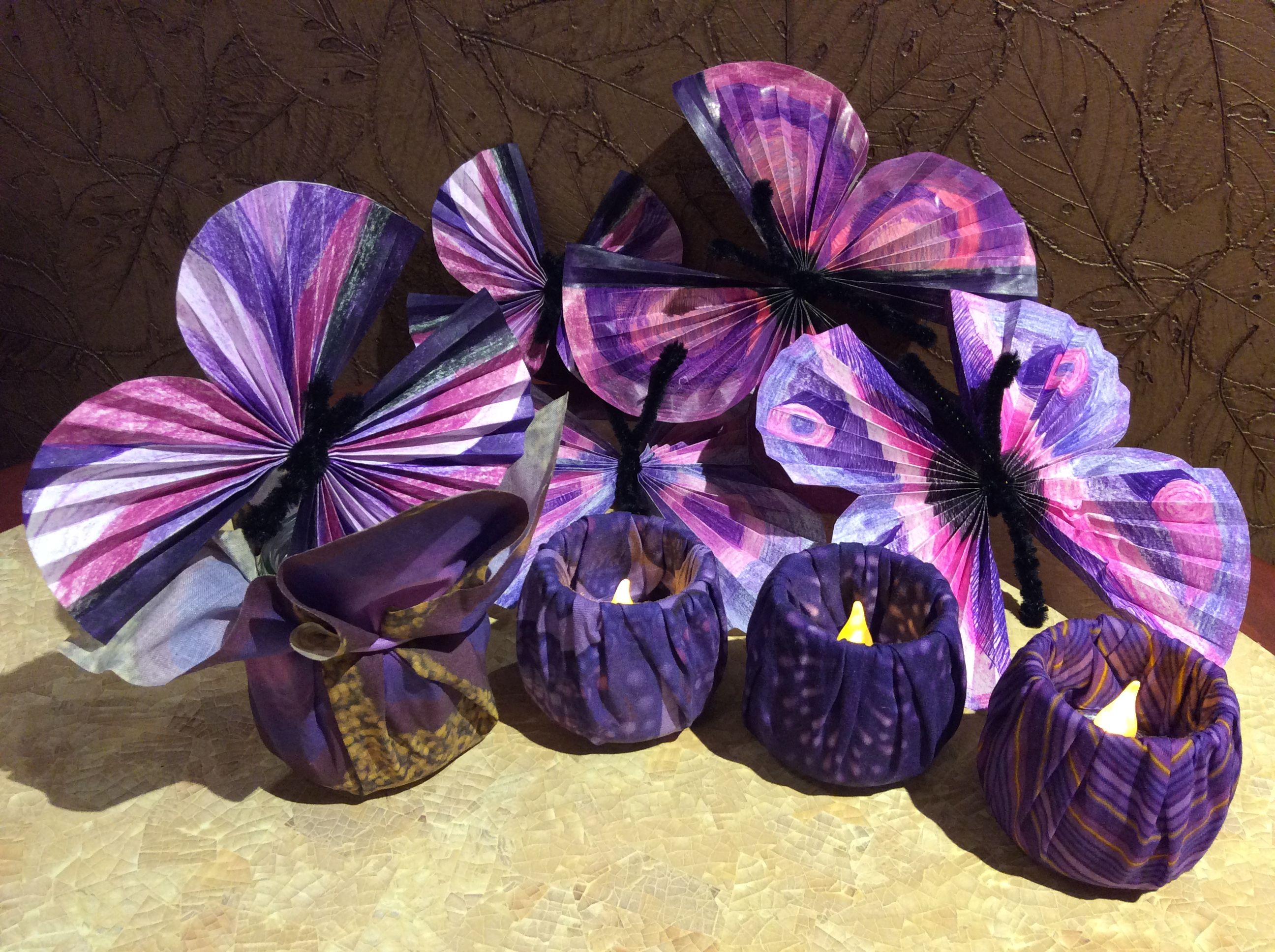 Purple Butterflies made from office paper mistakes, colored, folded and tied.