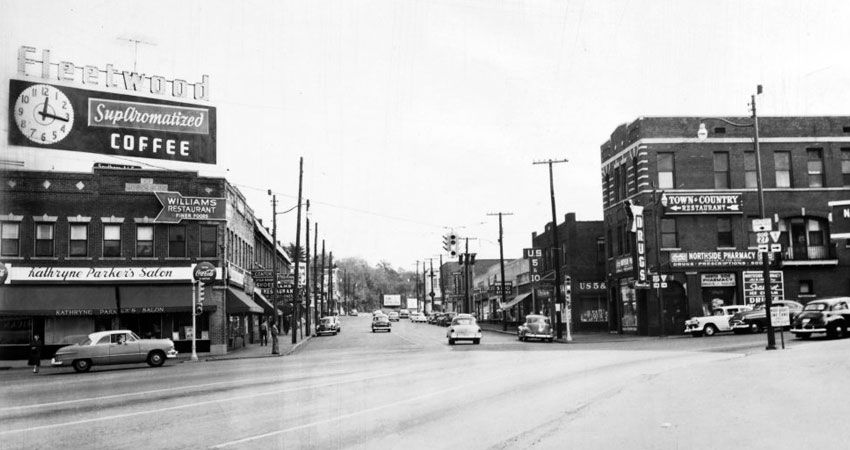 Deep Zoom Chattanooga-1955 Looking east down Frasier Ave. at North Market St. and Cherokee Boulevard. Pictured on the left is Kathryne Parker's Salon (located in Moses Building, erected 1919) and on the right Northside Pharmacy and U.S. 5&10.