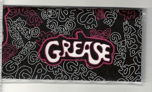 "Grease The Movie Logo Pink Checkbook Cover by Tickled Pink Boutique. $5.99. Fun and functional for every day use without paying a designer price for a designer name!  The sturdy clear plastic lightweight VINYL COVER encases a fabric bonded design. Measuring 6 1/4"" x 3 1/4"",  the cover fits all standard bank checkbooks and banking registers.  All checkbook covers come with a register flap and a duplicate check flap  just like the bank, only flashier.  These checkboo..."