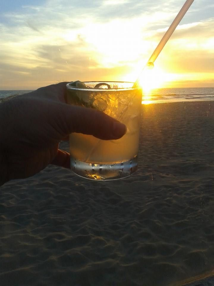 Having a margarita at the beach