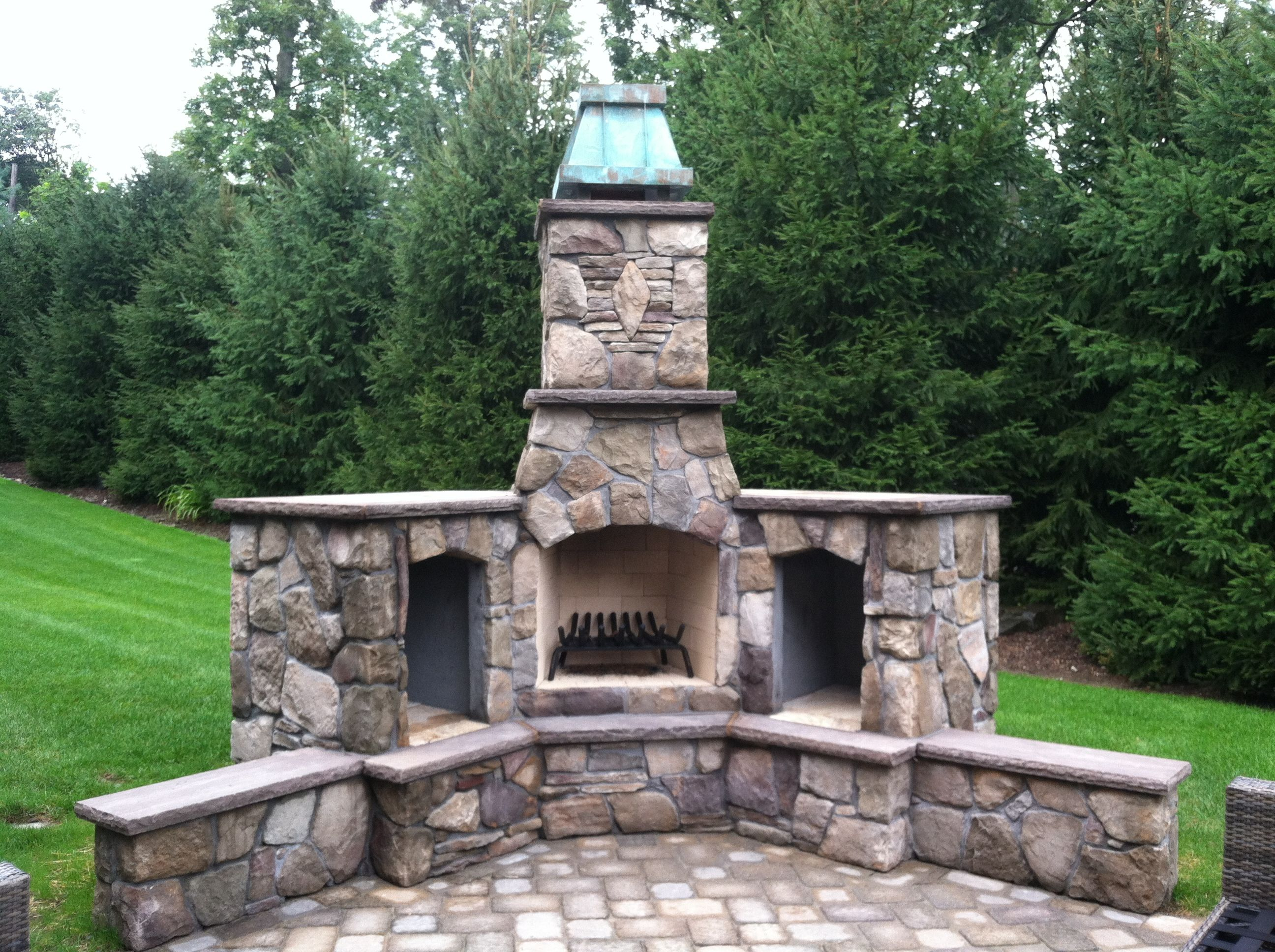 Royale Style Chimney Crown In Aged Copper From Chimneyking Com Outdoor Fireplace Made From Belgard Bricks Outdoor Fireplace Fireplace Chimney Cap