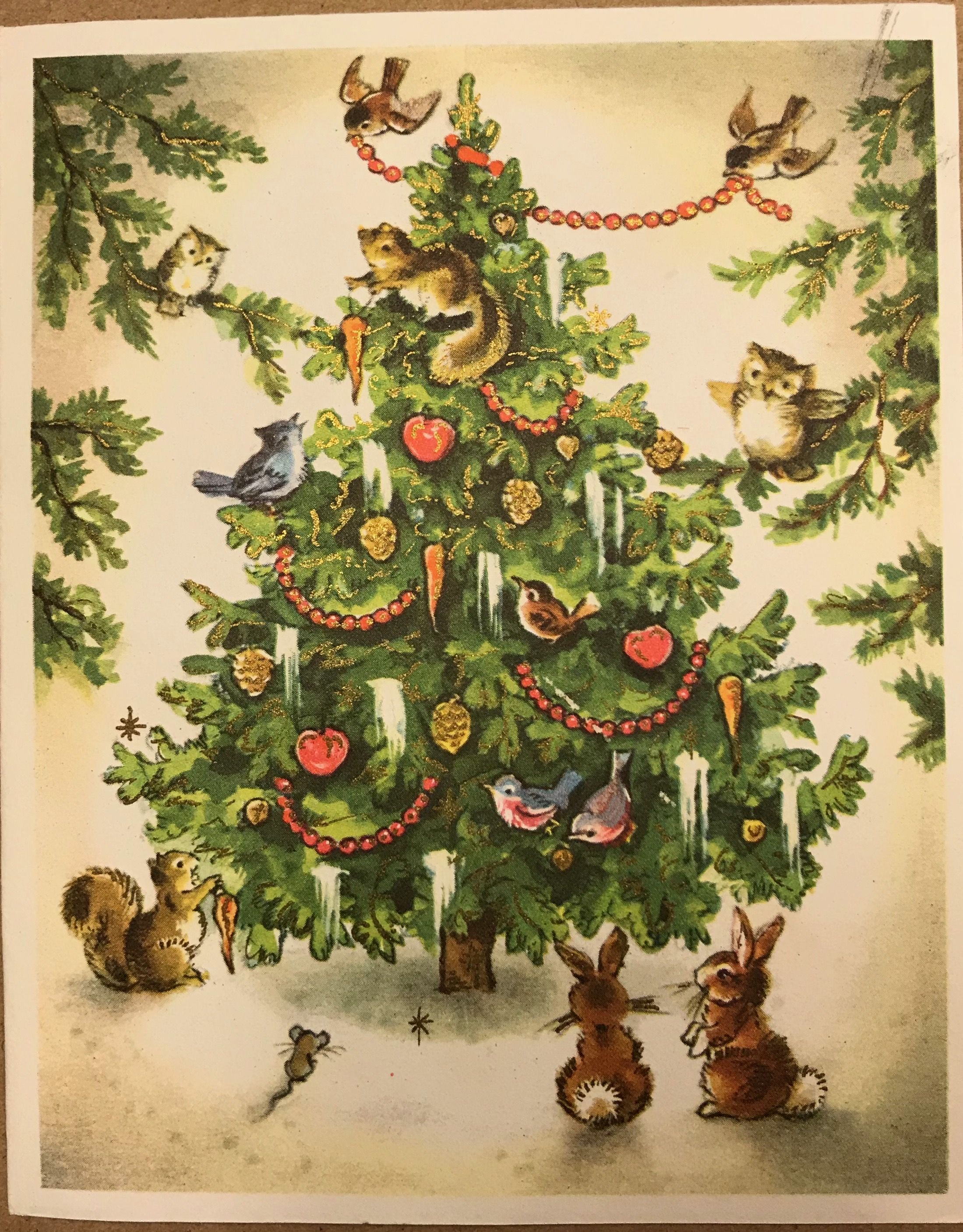 Woodland forest animals around a Christmas tree (With ...