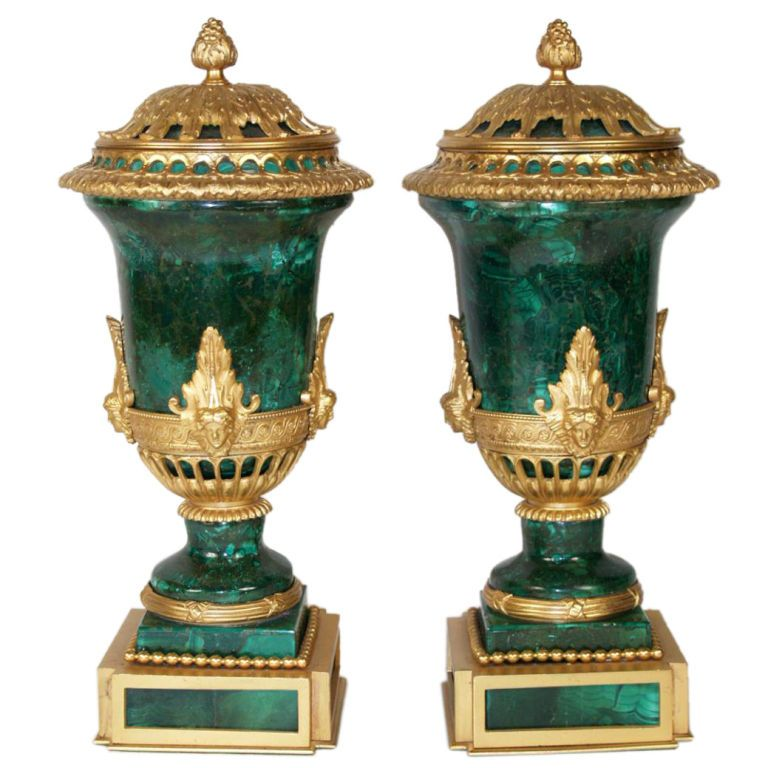 Pair of Louis XVI style Malachite & Ormolu cassolettes, continental, each embellished with various ormolu mounts on a square base. Tops have been secured. Made in France, Circa 1890. LENGTH: 	3.75 in. (10 cm)  DEPTH: 	3.75 in. (10 cm)  HEIGHT: 	11 in. (28 cm) - HILLCREST Collections, Palm Beach, FL