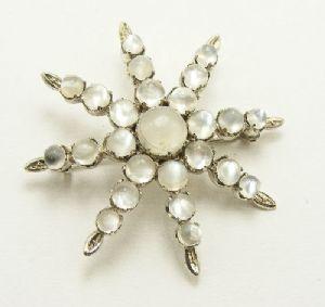 Antique moonstone star brooch