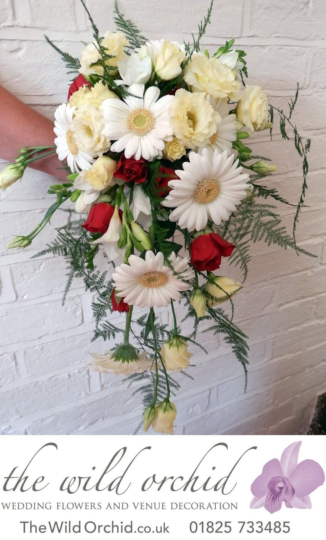 Wedding bouquets teardrop  A showerteardrop bouquet of white gerberas cream lisianthus and