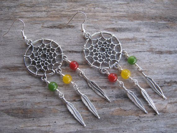 Rasta Dreamcatcher Earrings LARGE with Feathers by Abundantearthworks   #dreamcatcher #dreamcatcherearrings #rasta #rastaearrings #redgoldandgreen #feather #featherearrings #dangleearrings #bohoearrings #boho #southwestern #reggae #jamaica #ethiopianjewelry #HaileSelassie #under25 #abundantearthworks