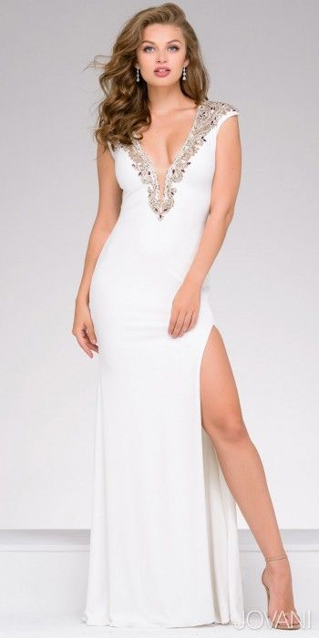 Show some skin in the fabulous and elegant Plunging Cap Sleeve Cutout Evening Dress by Jovani. This sultry style features a plunging V-shape neckline, a sheer illusion panel and cap sleeves. The straight silhouette also includes embellishments along the neckline and around the cutout back as well as a thigh high slit. #edressme