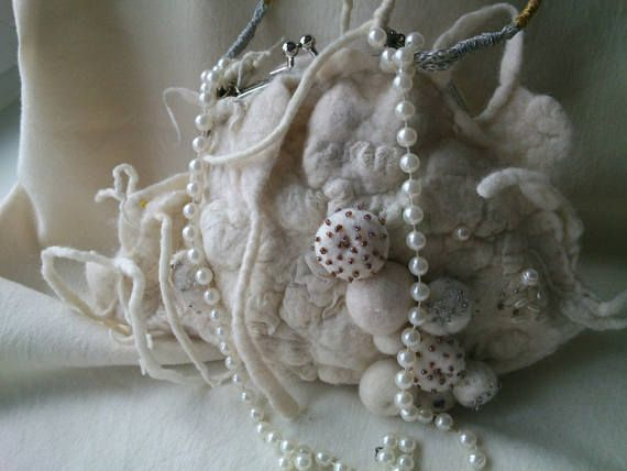 Handbag is a shell. From the sea-bed. Felt silk
