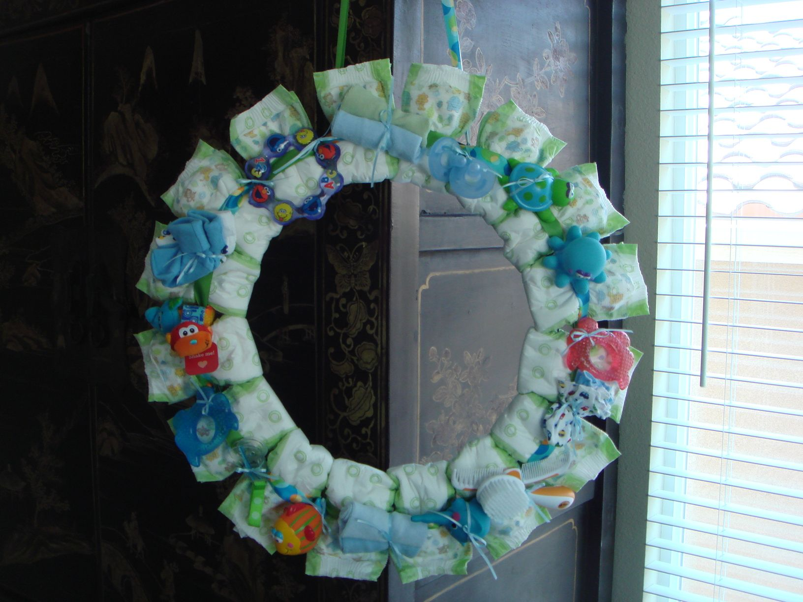 Diaper Wreath I made. Wire wreath ring from Michaels. Secure diapers ...