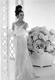 """Audrey Hepburn's gown in her film """"My Fair Lady"""" has receievedattentionsince the film was released in 1964. The """"sheath"""" fit of this gown isn't the only thing thatgave it a uniquelook. The gown's crystal workupgrades the gown tocouture and glamour."""