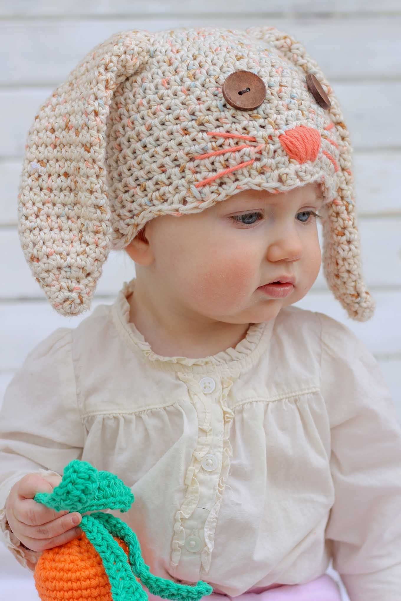 This free crochet bunny hat pattern makes a darling DIY Easter gift for your favorite baby or toddler. Pair with our free crochet carrot baby toy pattern.