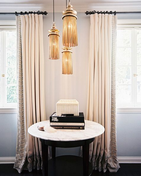 Jennifer Dyer - A vintage light fixture above a marble side table