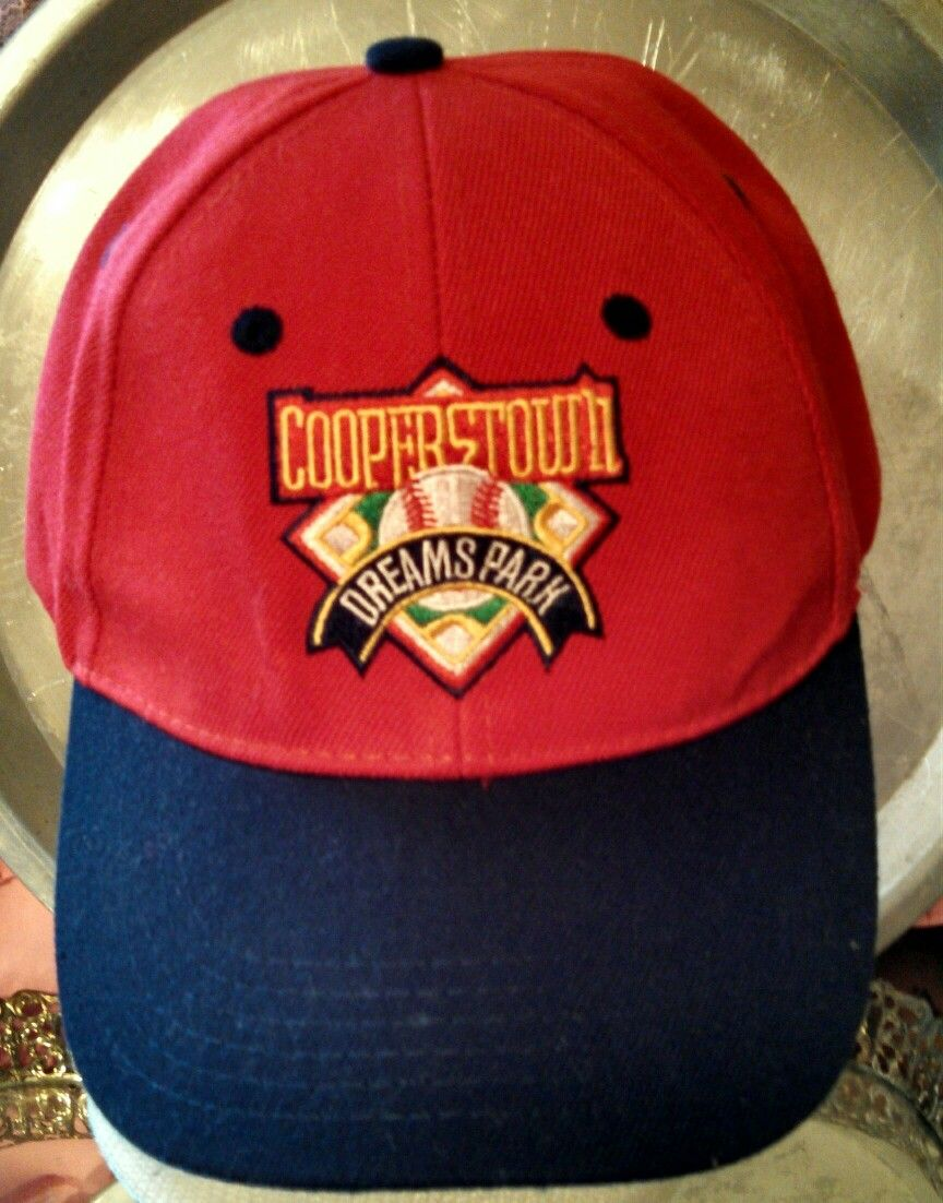Red crown and navy bill with embroidered full-color Cooperstown Dreams Park  logo. Adjustable  one size fits all. NO LONGER AVAILABLE IN THE DREAMS PARK  ... f7eb927860d7