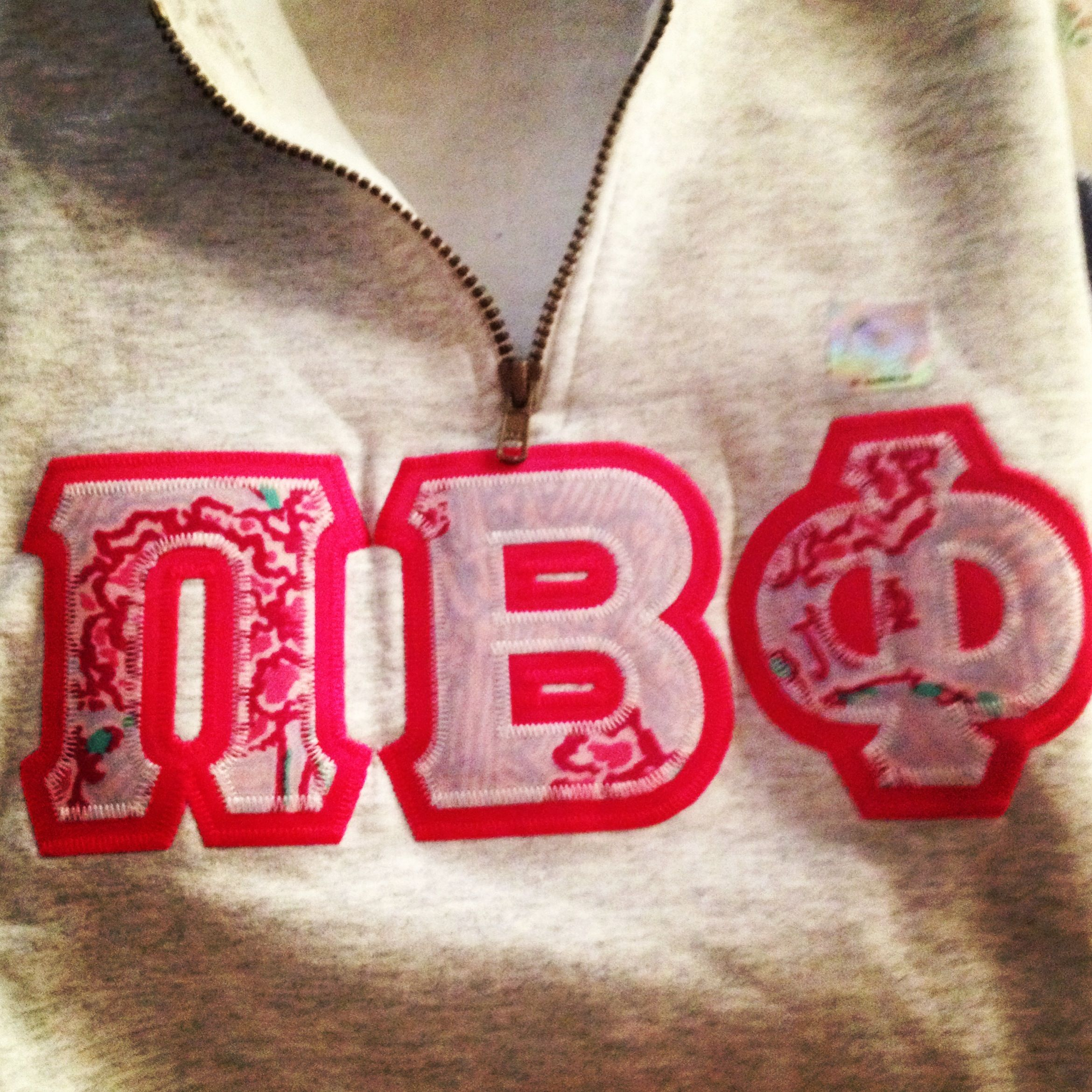 pi beta phi lilly pulitzer sorority print letters on a quarter zip sweatshirt