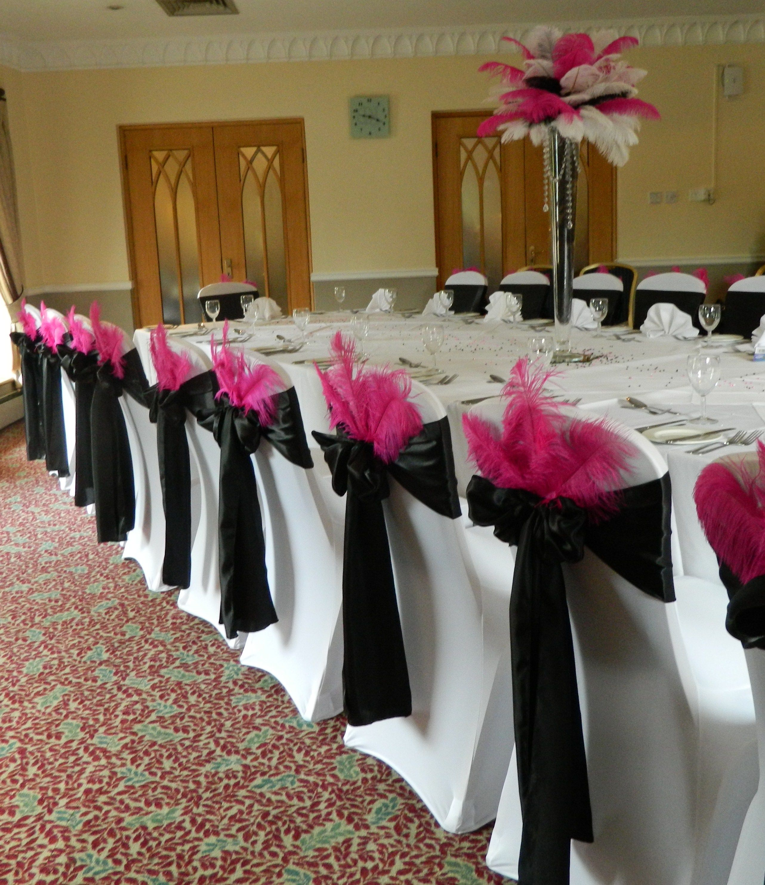 Black satin sashes pink feathers and feather centerpiece for 18th birthday party decoration ideas
