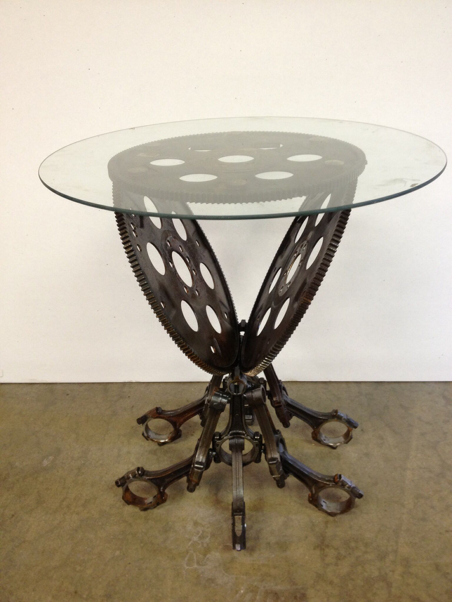 Sold End table made from pistons and flywheels