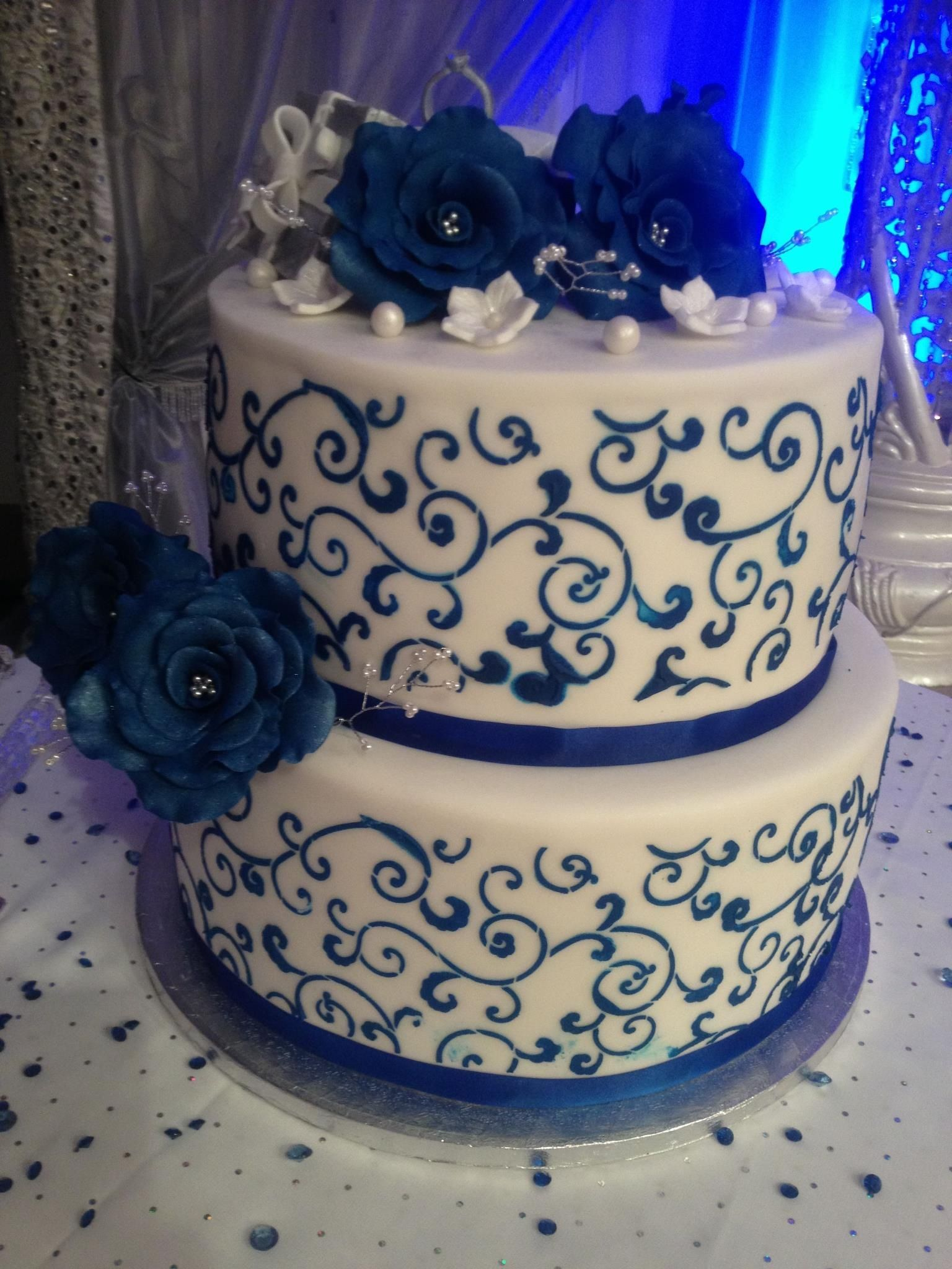 Love This But Only 1 Tier Not Two Keep Swirls But Make Lighter Blue And Have Those Flowers On Top In Li Wedding Cakes Blue Wedding Cake Navy Engagement Cakes