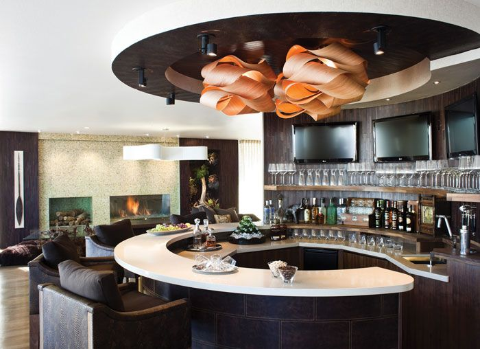 Captivating A Curvilinear Indoor Bar Offered Cocktails For Event Guests. Photo: Zach  DeSart