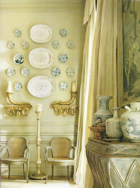 adore the wall grouping of blue and white plates, not to mention the ...