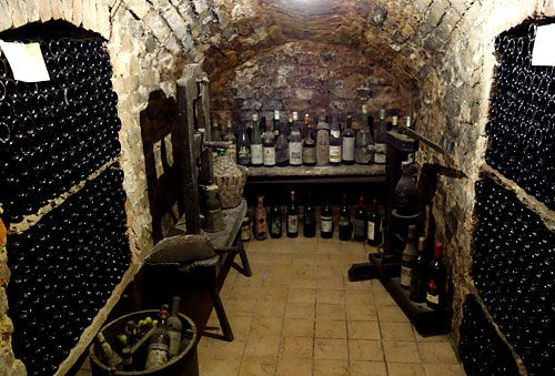 The goal for The Capone Wine Cellar - this old cellar dates back to 1790.  The side wall pull you in and the back wall is the focal point. It's utilitarian, it's about the wine.