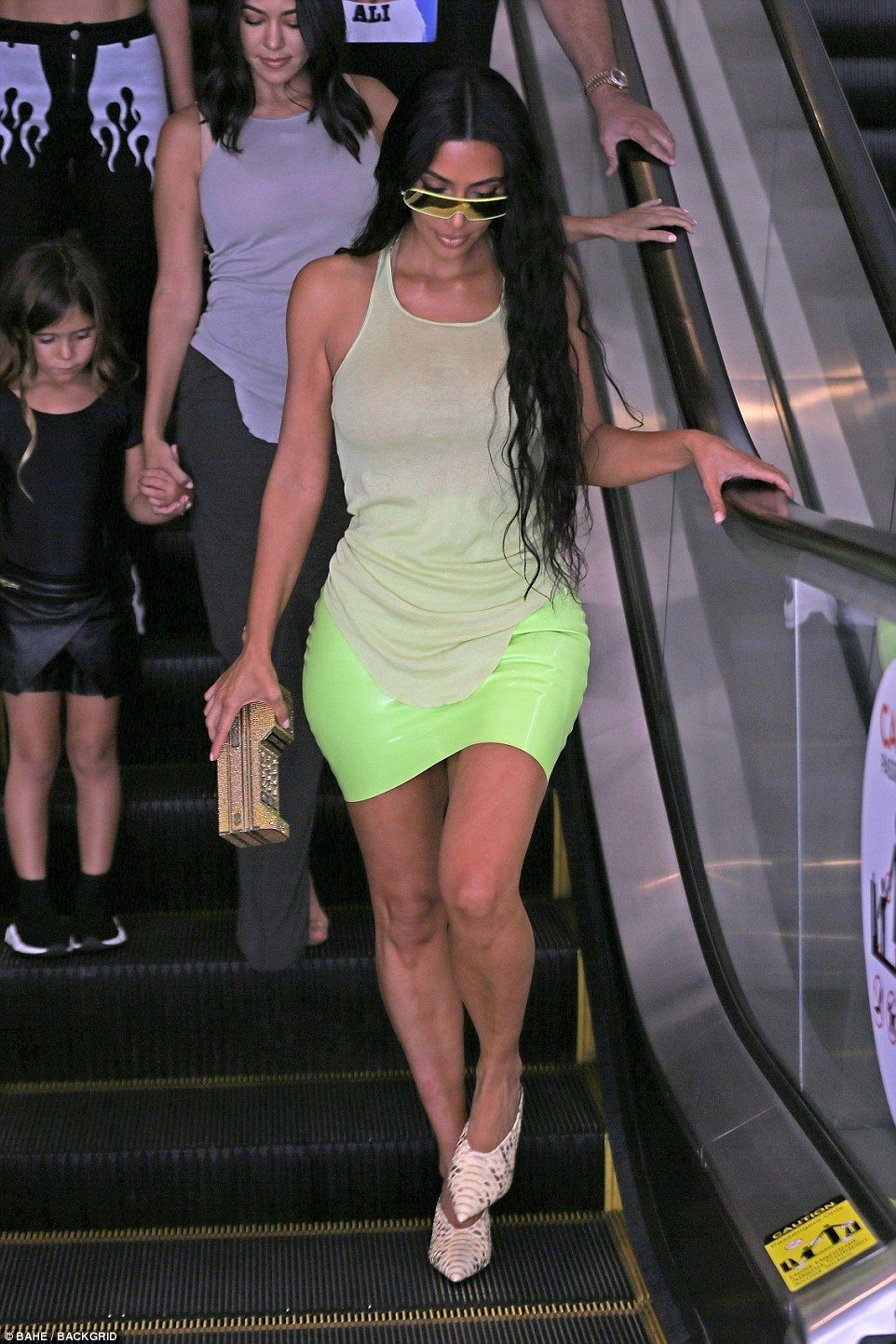 514317e5daf Kim Kardashian commands attention in clinging neon green mini skirt ...