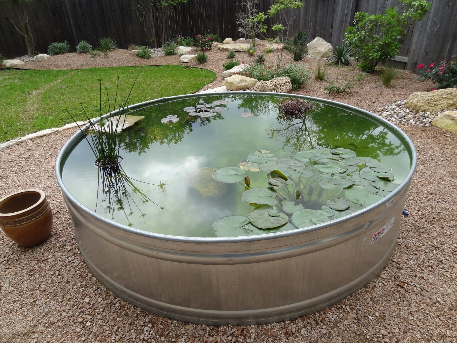 A Pond In A Large Metal Tub Ponds Backyard Fountains Outdoor