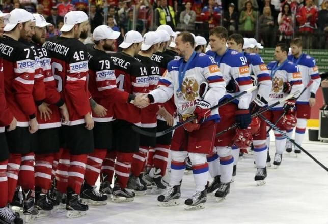 Russia's players shake hands with Canada's player during the victory ceremony of the Ice Hockey World Championship final game at the O2 arena in Prague, Czech Republic May 17, 2015.    REUTERS/David W Cerny