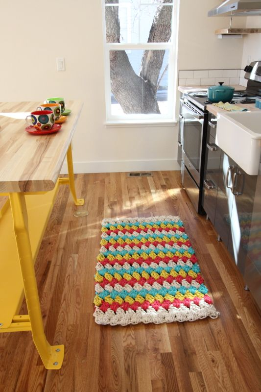 Great colored rug for kitchen, red, yellow, turquoise and ...