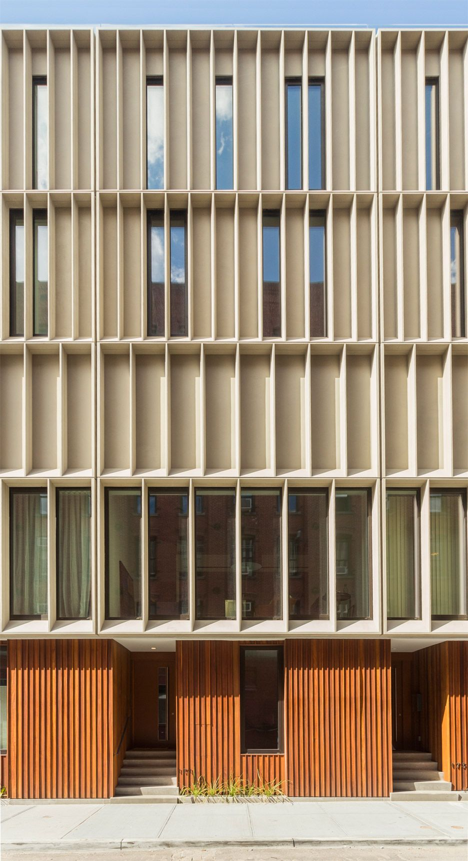 Wood Pattern Elevation : Concrete upper stories create fins for privacy shade