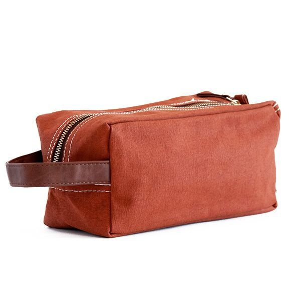 "Camel Waxed Canvas Travel Case LG: 9"" x 4.5"" x 4.5"" Printed on recycled canvas with eco-friendly pigment inks. Ideal for toiletries and travel essentials. The interior waterproof lining makes cleaning"