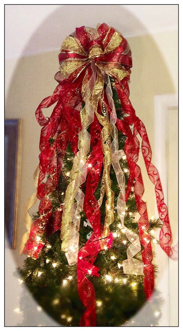 A personal favorite from my Etsy shop https://www.etsy.com/listing/251274211/wreathbow-package-red-and-gold-tree