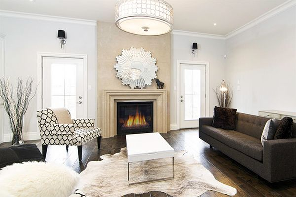 20 Living Rooms Adorned With Cowhide Rugs Rugs In Living Room Brown Living Room Decor Eclectic Living Room