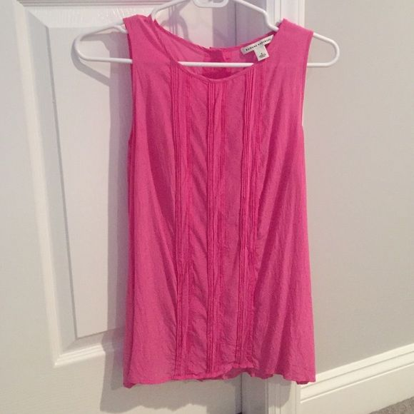Lightly worn Banana Republic pink sleeveless top Pink shift sleeveless tank from Banana Republic, size 4. Worn just a few times, in new condition. Buttons down the back as shown in picture Banana Republic Tops Tank Tops