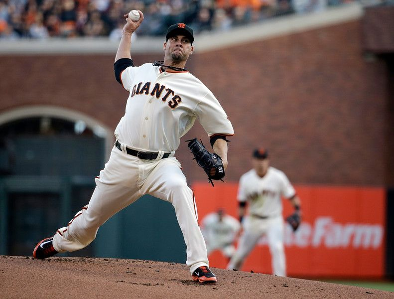 San Francisco Giants starting pitcher Ryan Vogelsong throws against the St. Louis Cardinals during the first inning of Game 4 of the National League baseball championship series Wednesday, Oct. 15, 2014, in San Francisco. (AP Photo/Jeff Roberson)