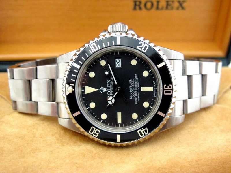 Rolex Seadweller , the Triple six ref 16660 , very very rare with matte dial , 1220m 4000feet , amazing patin , from 1982 sold in 1989 , with is Box under box , caledar , books , anchor , and punched papers !! a real Full set, Le Joaillier