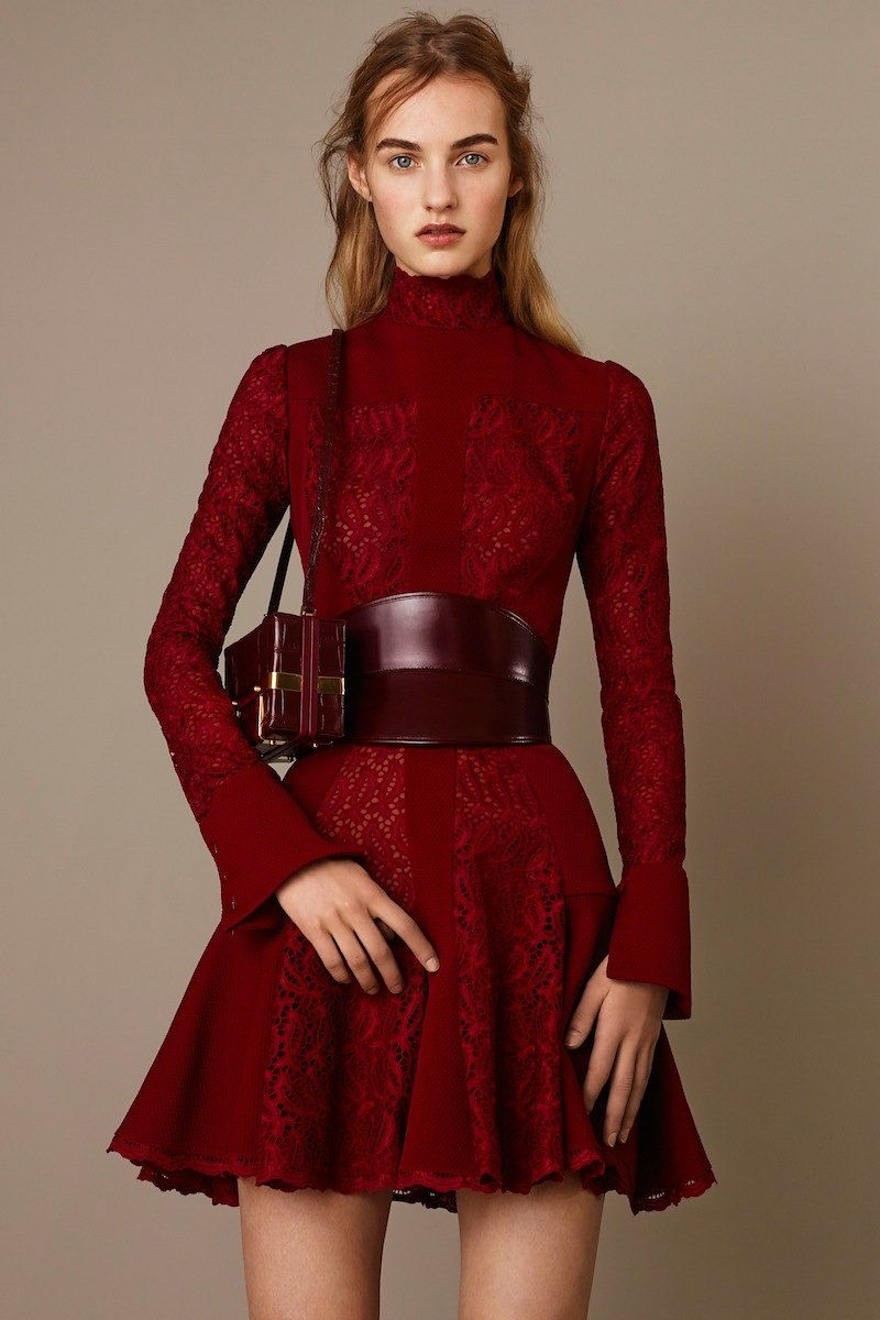 short, dark red, lacy with a really wide belt - Alexander McQueen Pre-Fall 2015 Runway