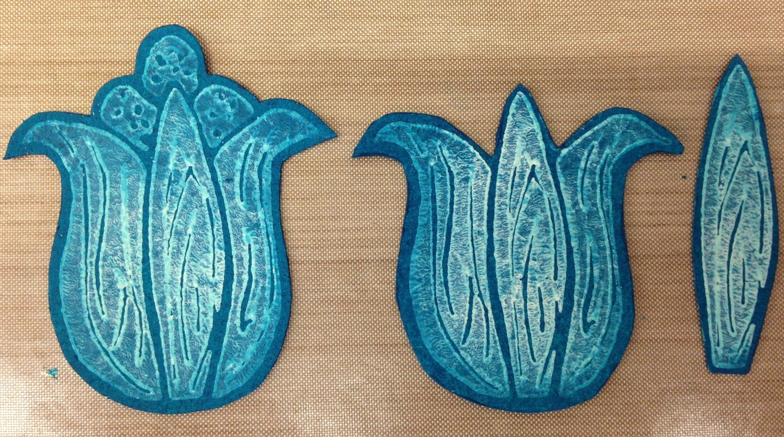 Now using Honey Dew, Beach Hut and South Pacific, print three tulip heads on the pre-painted Grungepaper and trim them